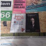 posters in De Volkskrant
